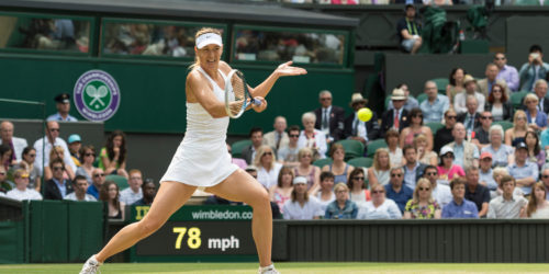 ED4A1H 01.07.2014. The Wimbledon Tennis Championships 2014 held at The All England Lawn Tennis and Croquet Club, London, England, UK. Angelique Kerber (GER) [9] (red NCP logo) v Maria Sharapova (RUS) [5] on Centre Court. Maria in action.